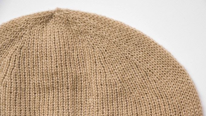 Detail of the beanie showing how stitches are automatically decreased to create the head shape.  Knitting time 50 minutes. Video below of the entire process of a smaller beanie (to fit the camera framing). Knitting time 20 minutes.