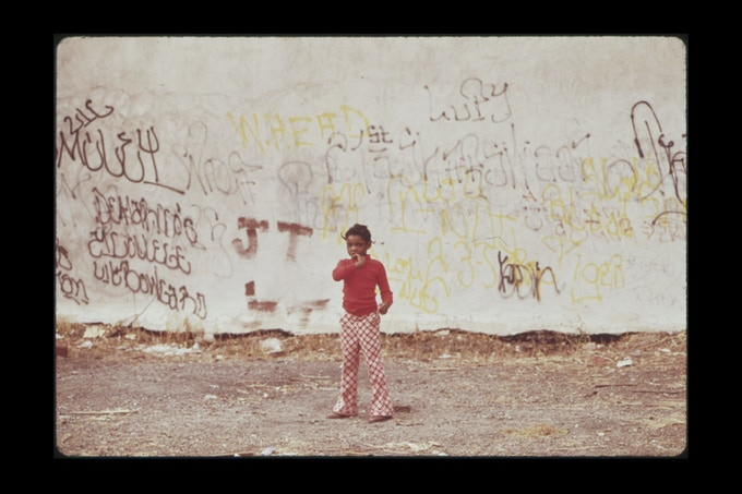 Boy In Back Alley In North Philadelphia, August 1973. Photographer: Dick Swanson