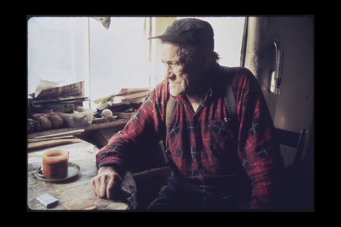 Uncharacteristically Somber, This 76-Year-Old Native of East Randolph, Vermont, Finishes His Morning's Third Cup of Coffee. Photographer: Jane Cooper