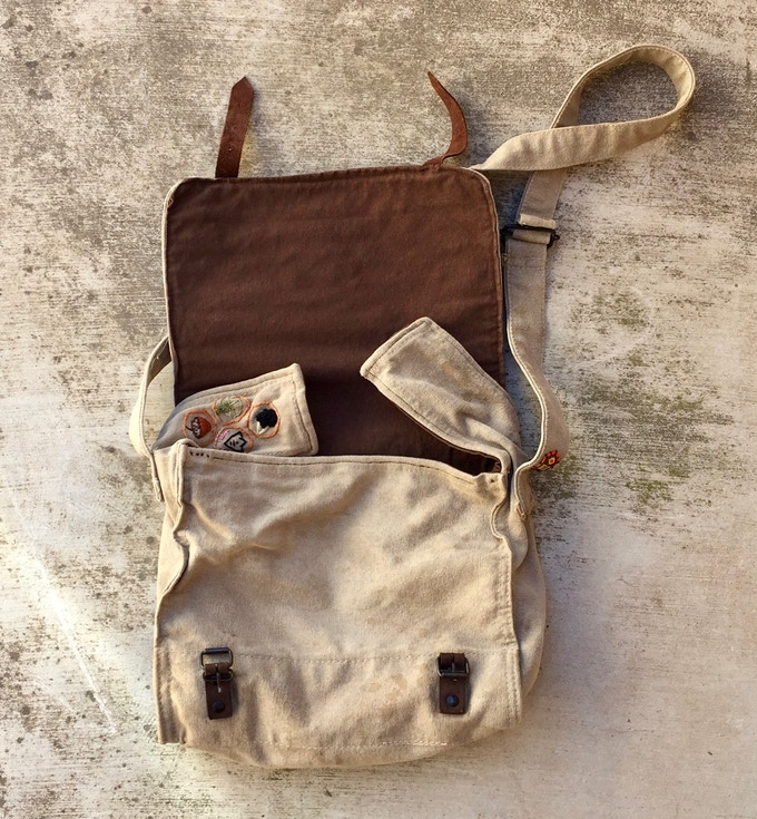 Inside is custom-lined with brown cotton duck canvas