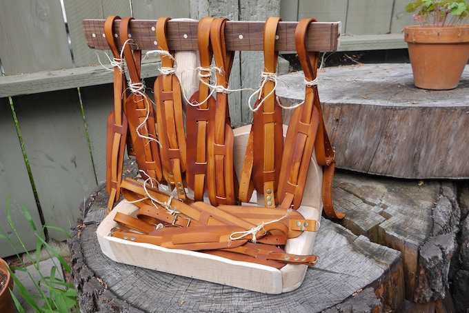 Camera Strap Display made from guitar wood left over from our neighbor who makes guitars.  We recycle and reuse at every opportunity.