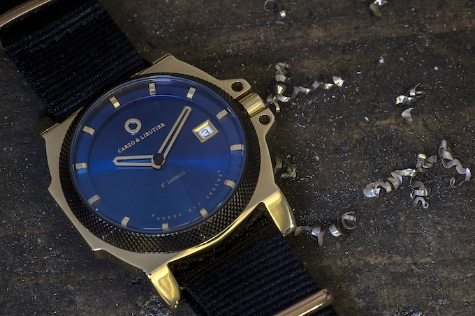 St Luxeuil Quartz. Blue & Gold PVD coated