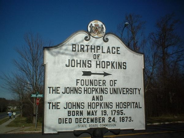 Historic marker, located on Johns Hopkins Road, near the entrance to Whites Hall
