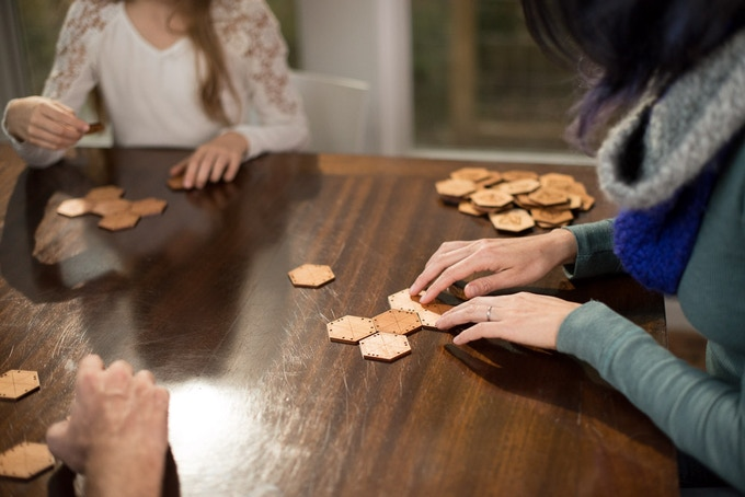"""Bloom is a game in which players attempt to create a """"flower"""" of seven tiles. It's a great game for families which can be played competitively or cooperatively!"""