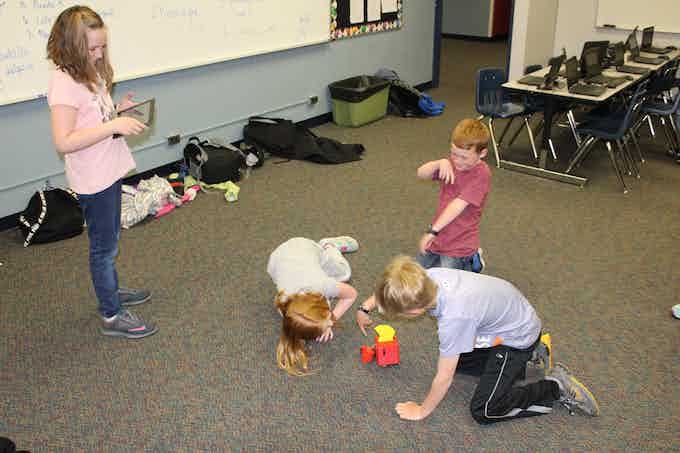 A Group of Grade-schoolers Trying our the LittleBot