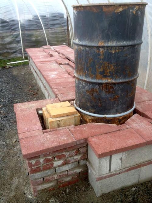 Greenhouse rocket mass heater