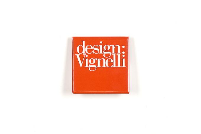 """2"""" square red pin with design:Vignelli logo"""