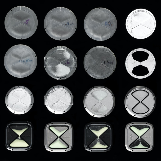 Various R&D stages of the luminous hourglass caseback.