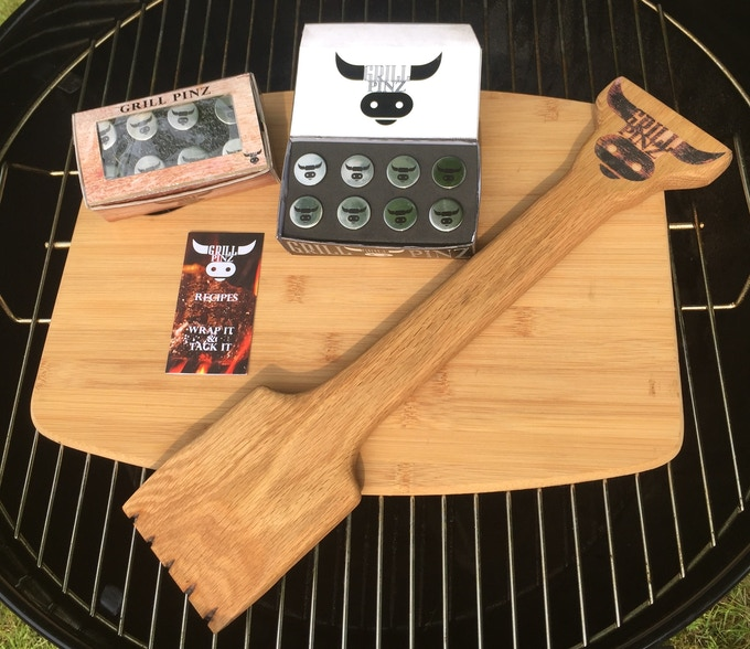Two sets of Grill Pinz with prototype packages, the full color recipe booklet, and our Oak Grill Scraper