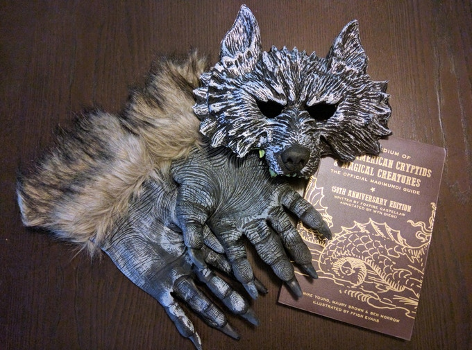 A werewolf mask, gloves, and a copy of Compendium of North American Cryptids & Magical Creatures is included in our Deluxe Edition!