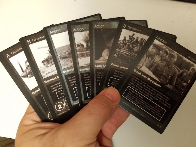 A player's hand can include troop, action, leader, and unit cards.