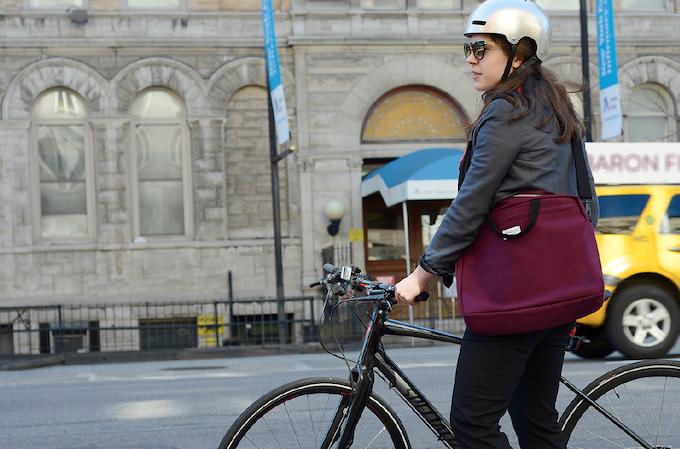 Caroline Weaver, entrepreneur, riding her bike to CW Pencil shop