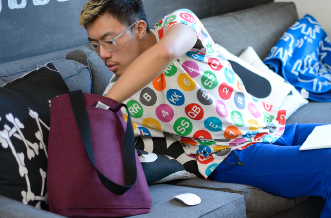 Zipeng Zhu, designer, at his home studio preparing to leave