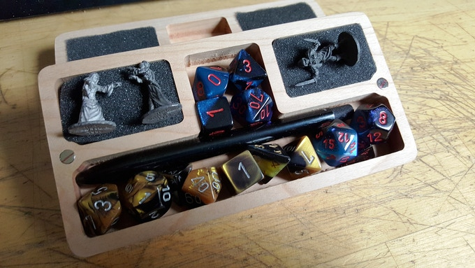 Two sets of standard Chessex dice plus a pen/pencil + 2 - 4 miniatures.