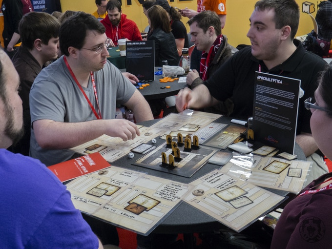 The game being played at the IndieMEGABOOTH during PAXEast 2017 - we used laminated player sheets to save paper, and liked them enough to put them in as a stretch goal