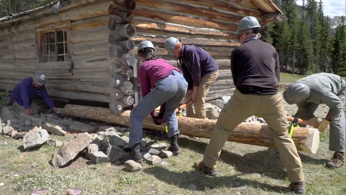 Replacing the bottom log - Simpson Lake Cabins restoration.