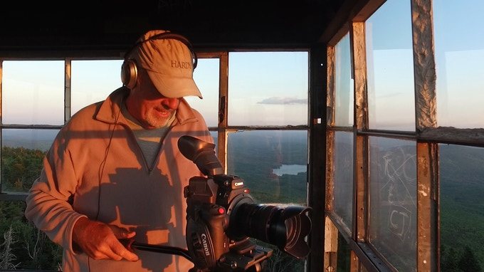Filming SAVING PLACES® at sunset from atop the Smarts Mountain Fire Tower.