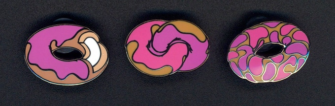 Look! Cloisonné pins of my donuts, one of which is included when you choose an 82 Donuts print. Click to see super cool NYPD officers wearing them!