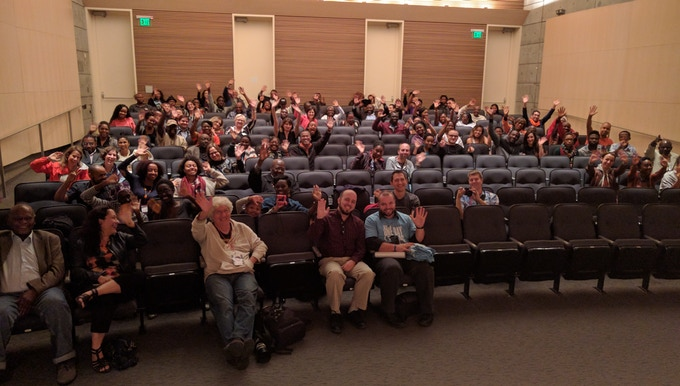 The audience at the SVAFF screening of NAIJA BETA waves their enthusiasm for the film after the Q&A.
