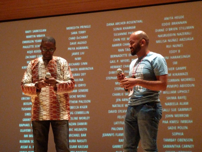 Kickstarter credits roll as SVAFF festival director CHIKE NWOFFIAH and film director ARTHUR MUSAH prepare for a Q&A after a screening of our ONE DAY I TOO GO FLY spinoff NAIJA BETA.