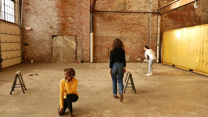 Rachel working with chorus members Le'Ecia Farmer and Katelyn Norris at the Brickhouse