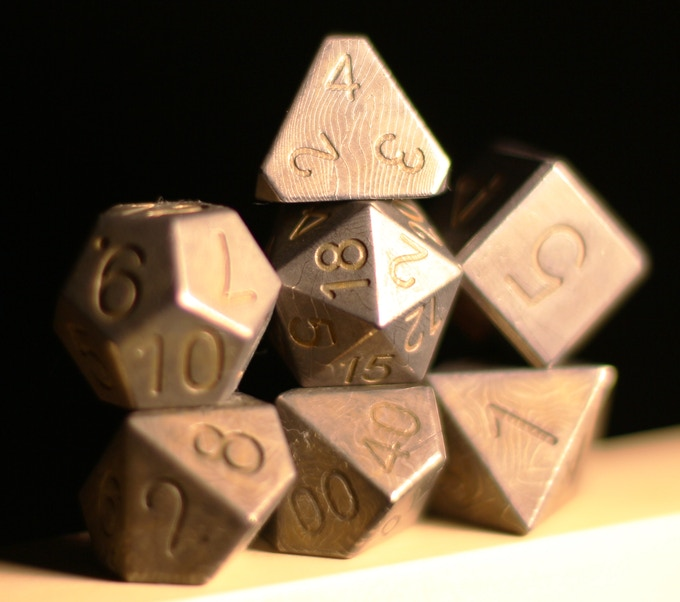 Hand-Forged Damascus... hours and hours of work to hammer and twist to produce these amazing dice.
