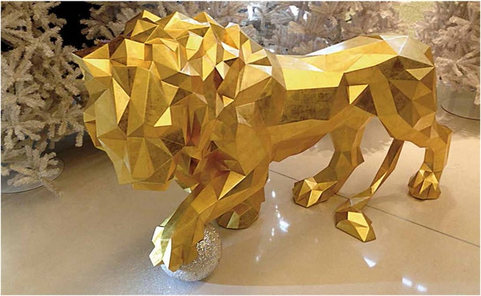 © Chanel, Gold Lion, lifesize statue