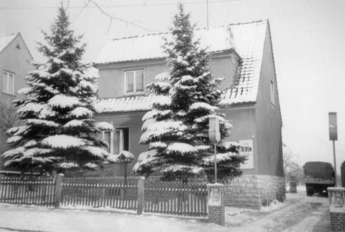 Our house in 1955/56 where my parents and grandpa lived. Some years later I was born there. At this time my father had a beer trade. As you can see (and I wish we had kept him) my father had a 12 year old Wehrmacht Opel Blitz as a transport vehicle.