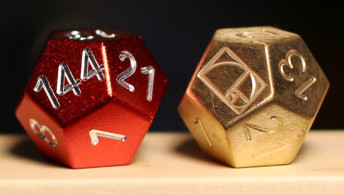 The Aluminum and solid brass (Golden Spiral) Fibonacci dice. Go from oh.. to OH SHIT! with a single roll.