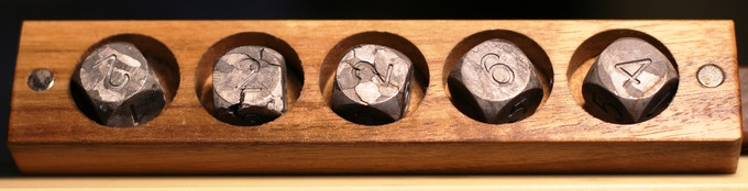 Space Yatze HO! Five of the nicest round edge CAMPO del CIELO meteorite dice you'll ever find in a set. This is a 1/1 item.