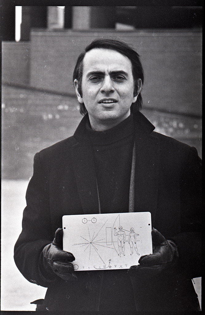 Carl Sagan holding the Pioneer plaque