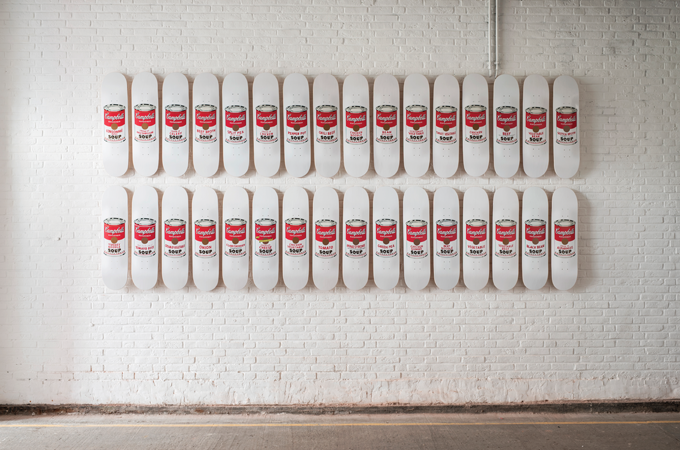 Wall of decks by Andy Warhol Foundation x The Skateroom
