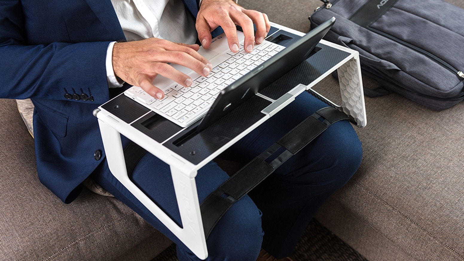 The world's most versatile and ergonomic phone, tablet & laptop stand – use any device, anywhere.