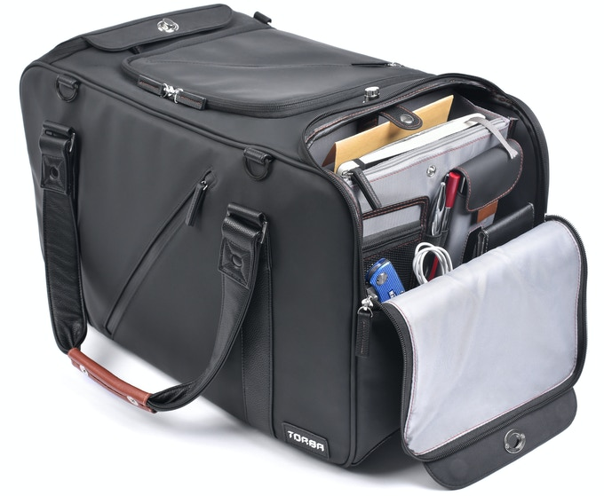 Electronics module easily clips in and out and is equipped with a dedicated smartphone pocket, a padded tablet compartment, a documents pocket, 2 mesh pockets for all your small items, and pen loops.