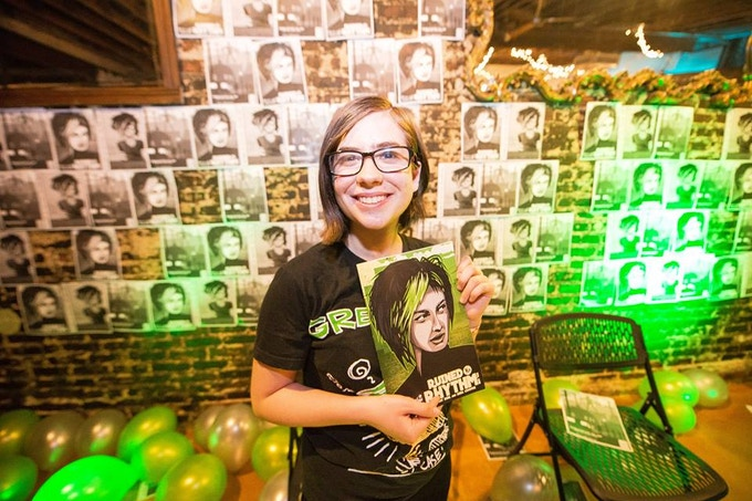 Luna Cooper, Co-Creator of Ruined My Rhythm, holding the original Matt Peppler cover of Volume One at the release party.
