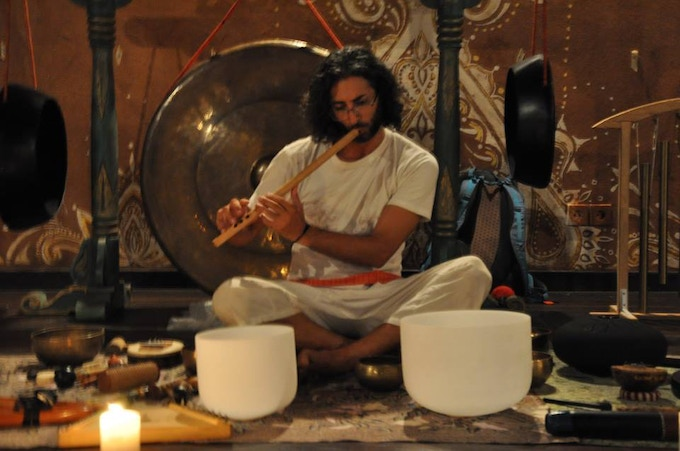 Shervin with traditional healing instruments