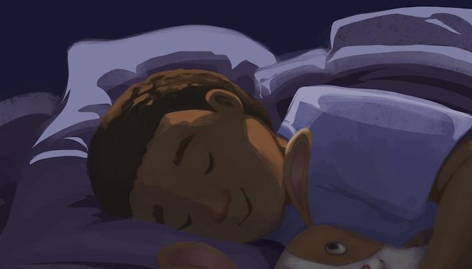 Boy Cuddling Rabbit