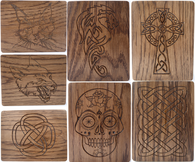 Clockwise from top left: cat, dragon. celtic cross, large celtic knot, day of the dead skull, small celtic knot, wolf