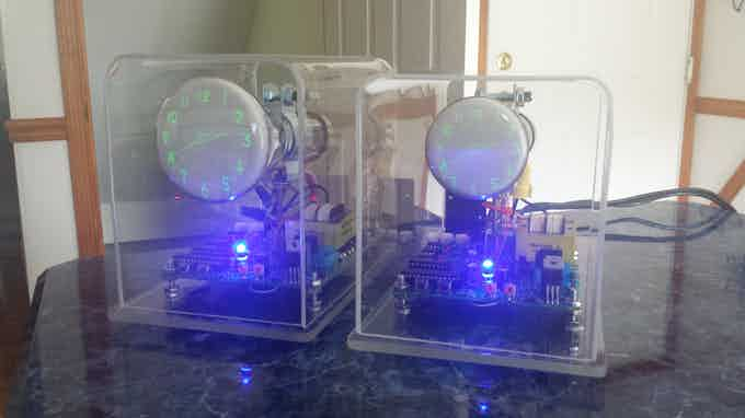 A DG7-6 OSC4.4 clock next to the 2BP1 version.