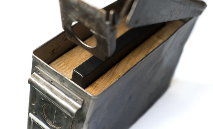The acid-free box is held in place by a wood insert inside the ammunition box