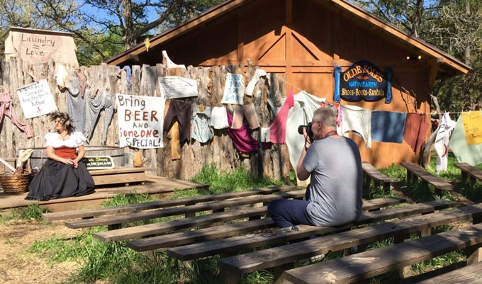 Artist Hans Bauer photographs a Sherwood Forest Faire participant near Austin, Texas, spring 2015