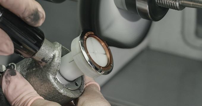 Caseback polishing by expert hands at La-Chaux-de-Fonds, Switzerland