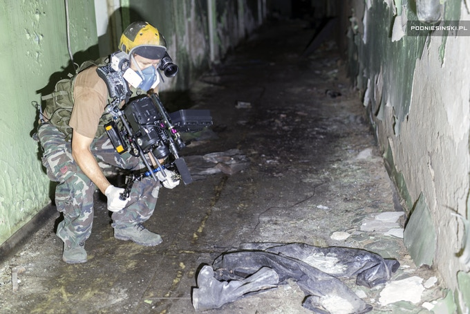 Filming the interior of the radioactive hospital basement. Pripyat. Chernobyl Exclusion Zone.