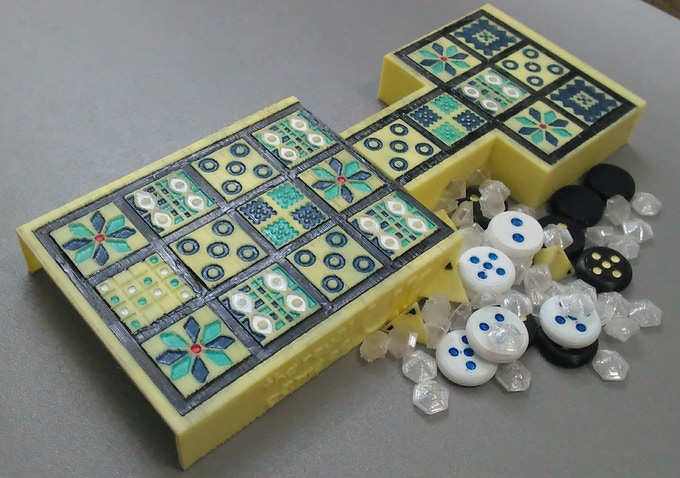 An example of a painted set with dice, tokens, and score diamonds