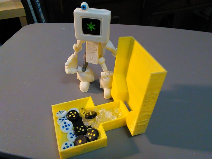 Cymon the Robot demonstrating the storage capabilities of this set