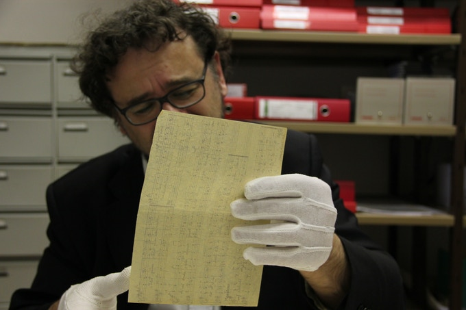 Francesco Lotoro analyzing documents