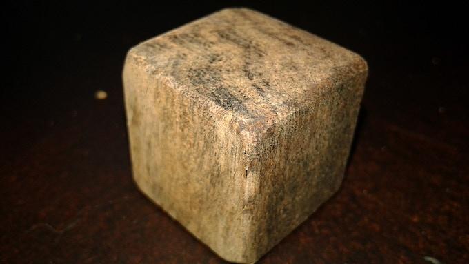 Partially sanded mahogany cube blank