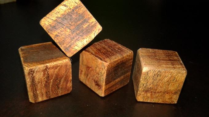 Partially sanded mahogany cube blanks