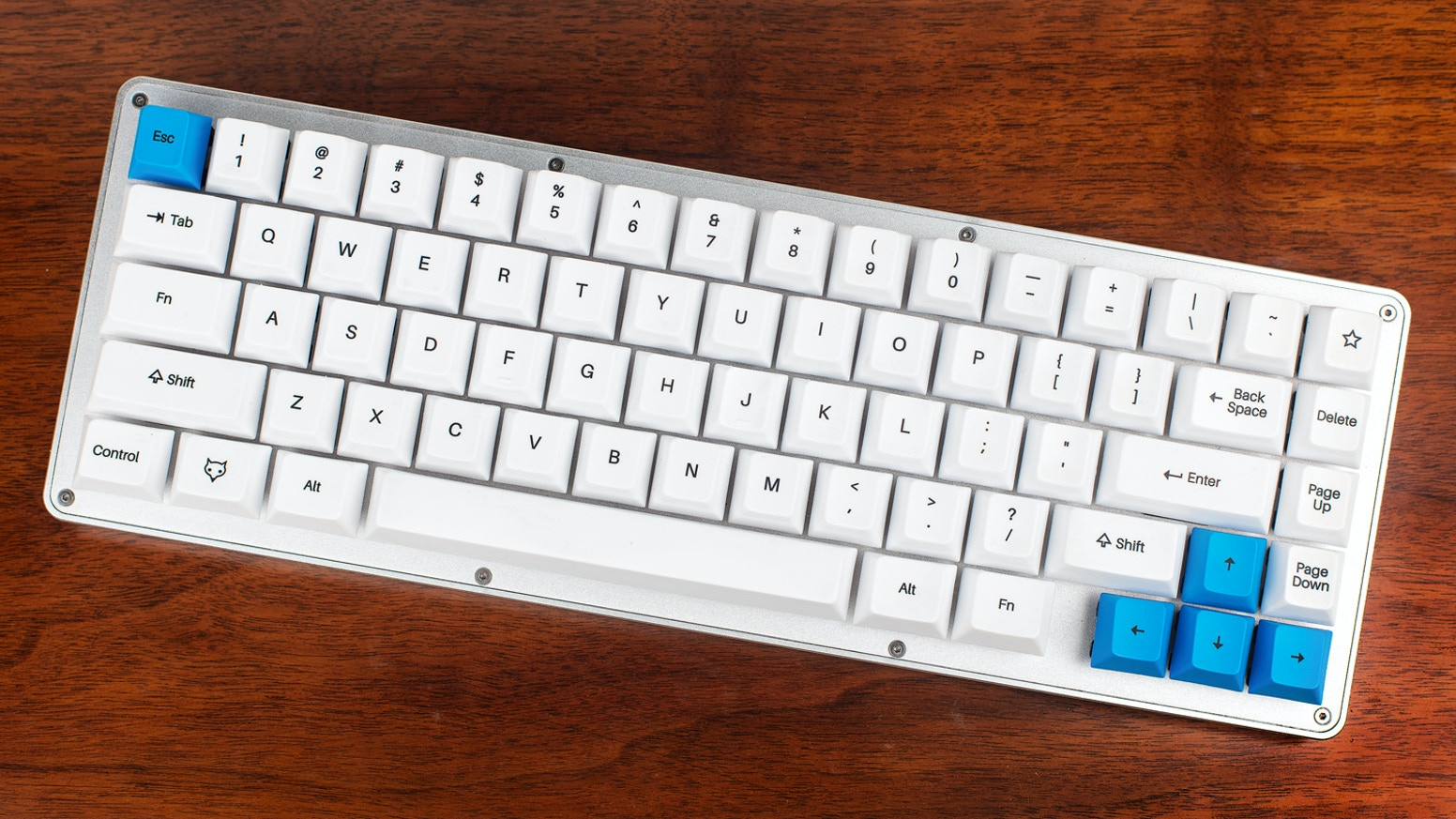 The WhiteFox is a fully programmable, compact keyboard with an aluminum frame and custom keyswitches. Designed by Matteo + Input Club.