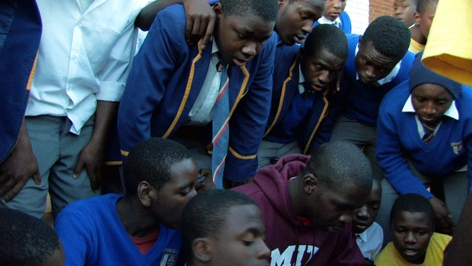 FIDELIS shares stories with students at his old high school in Nyanga, Zimbabwe